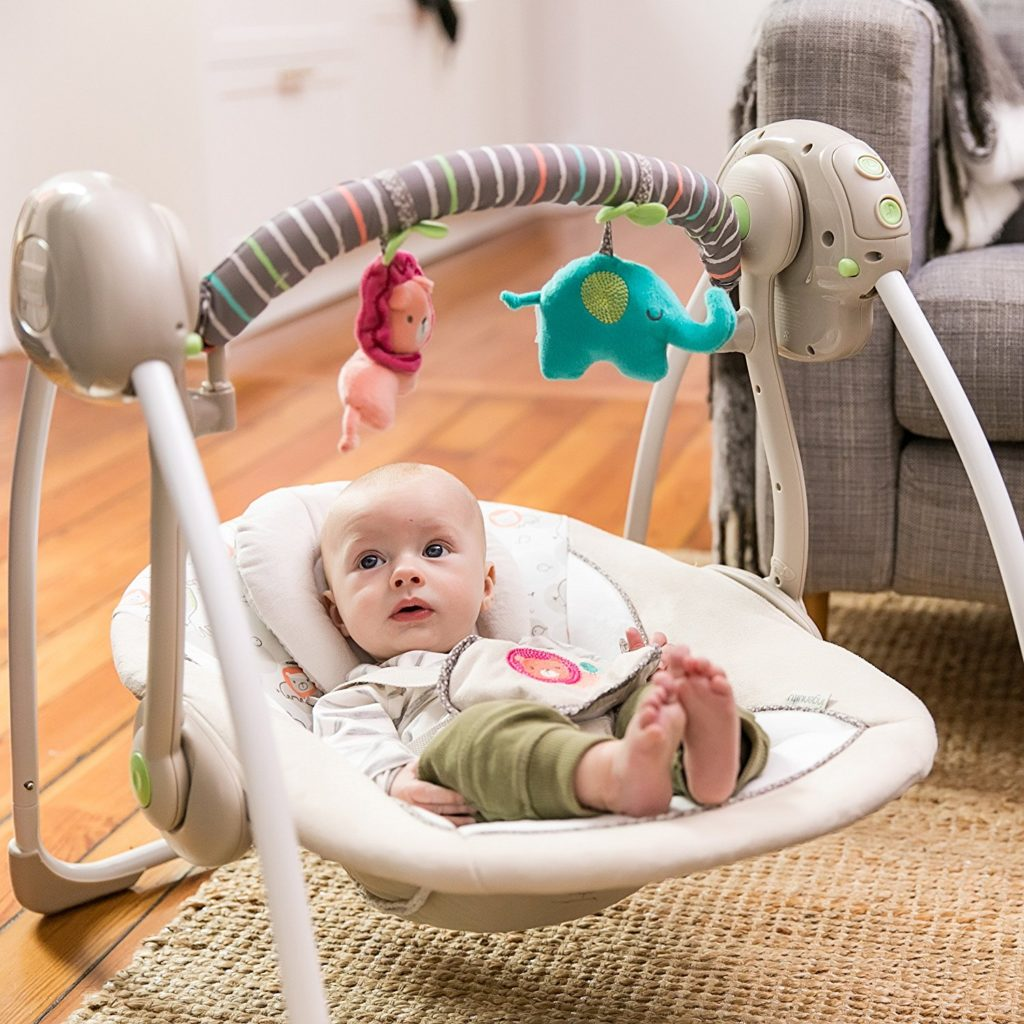 Ingenuity Cozy Kingdom Portable Swing with baby