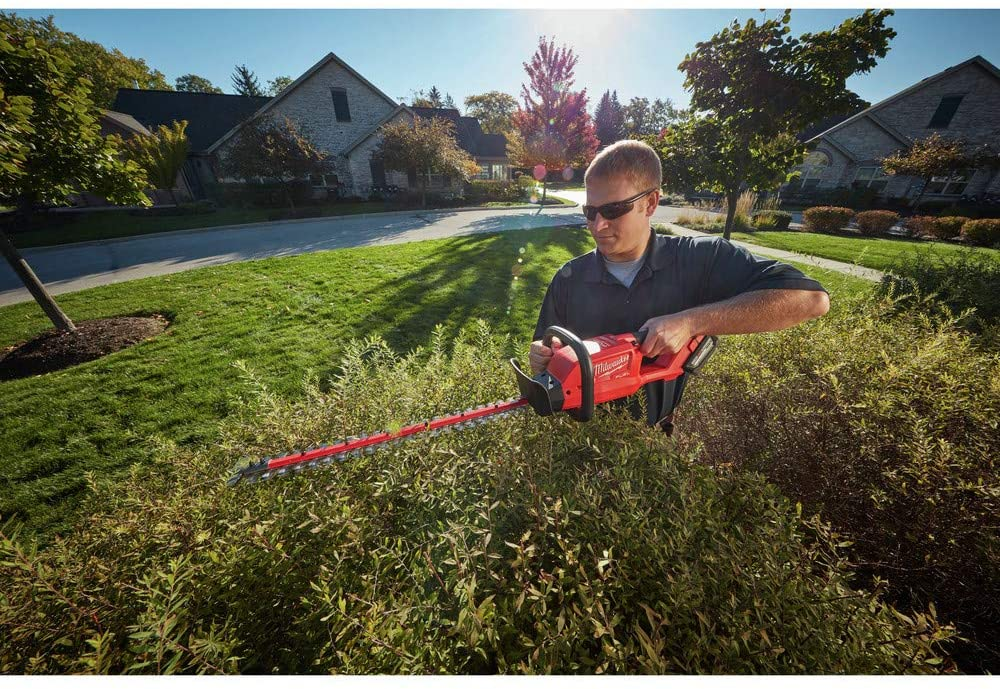 Milwaukee 2726-20 M18 Fuel Hedge Trimmer in action